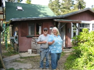 Archie and Hilloah in front of cabin